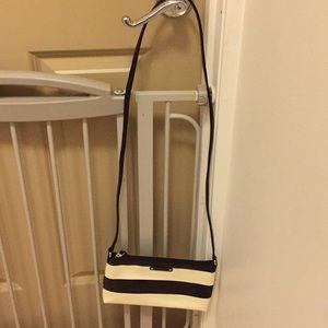 Black and white striped kate spade crossbody bag